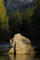 Huge granite boulder in the middle of the Merced River, Yosemite National Park, California