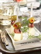 Anchovy,olive and manchego mini brochettes