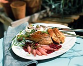 Stuffed leg of guinea_fowl with radishes and redcurrants