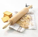 Crushing the rich tea biscuits with a rolling pin