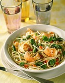 Spaghetti with langoustines and vegetables