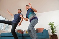Two young men playing motion sensor video game