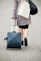 travelling woman with suitcase and bags, high heel, Geneva, Switzerland