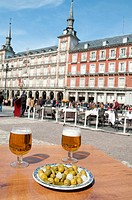 Olives and beer for two, Plaza Mayor. Madrid, Spain