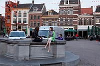 Girls talking on square De Hof in the city centre of Amersfoort, Netherlands