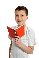 Smiling school student holding small book
