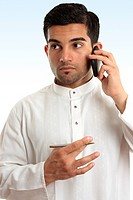 Ethnic business man using phone