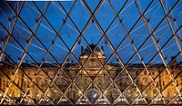 Louvre Museum and pyramid by architect Ieoh Ming Pei at night, Napoleon Court, Paris, France