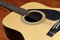An acoustic guitar at rest