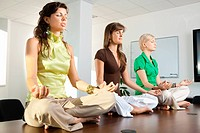 Businesswomen sitting in lotus position