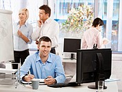 Casual businessman working in office