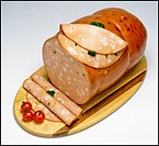 Mortadella sausage with slices on wooden board