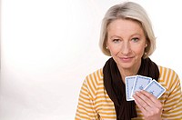Mature woman playing cards