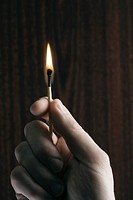 Woman holding holding lit match