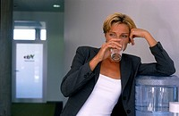 Exhausted Businesswoman with Glass of Water