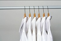 White shirts on clothes hanger in a row