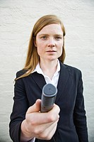 Young woman holding microphone, Melbourne, Victoria, Australia