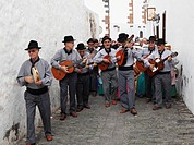 Spain, Canary Islands, Lanzarote, Traditional folk musician group at alley