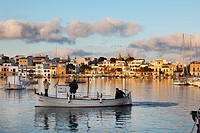 Spain, Balearic Islands, Majorca, Portocolom, Fishermen in boat on river