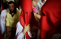 Penitents stand inside a church waiting to start an Easter Holy Week procession in Carmona, Seville province, Ansalusia, Spain, May 19, 2001  The proc...