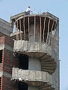 Structure of a building under construction with round staircase