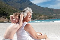 Older woman with grandson on beach