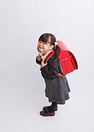 Girl carrying school bag