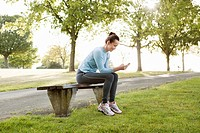 Runner using cell phone in park