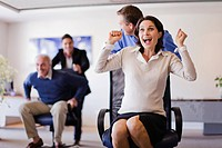 Business people having chair race