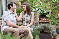 Smiling couple sitting together outdoors