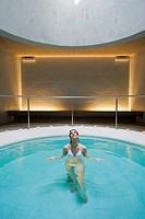 Woman standing in pool at spa