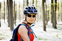 Mountain biker standing in forest
