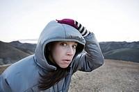 Surprised Woman Holding Hood on Head