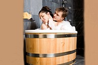 Couple having bath together