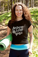Smiling Woman Holding Yoga Mat on Forest Trail, Oswald West State Park, Oregon, USA
