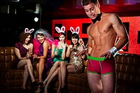 Young women on hen night with male stripper