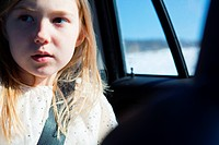 Young girl wearing car seatbelt