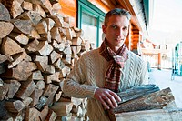 Man holding logs, portrait