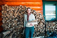 Man holding logs, portrait (thumbnail)