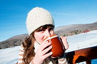 Girl drinking hot drink, portrait