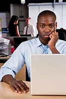 Serious black male office worker