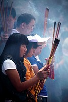 Prayers offer incense to Buddha in Yuantong Temple the famous Buddhist temple build during Tang Dynasty  Kunming  China