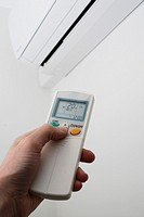 Adjusting the settings on a wall mounted air conditioning unit