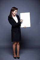 woman holding paper board