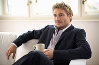Businessman holding cup of tea