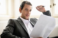 Businessman reading document