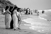 Indian women are at the beach of Varkala / India