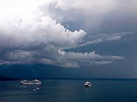 Southern Italy, Amalfi Coast, Piano di Sorrento, View of storm clouds and cruiseliners at sea