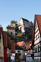 Germany, Bavaria, Franconia, Upper Franconia, Franconian Switzerland, Pottenstein, View of castle on top of mountain with town in foreground