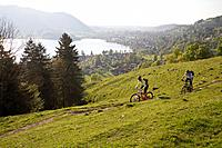 Germany, Bavaria, Schliersee, Man and woman moutainbiking on mountains
